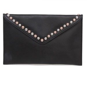 B LOW THE BELT x Revolve Studded Envelope Clutch